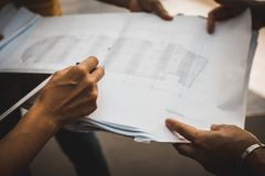 Soft focus of hand three industrial engineer. Engineering working and talking with drawings inspection on building outside. Engineering tools and construction royalty free stock photography
