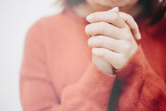 Hands Girl prayer to God stock images