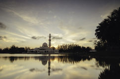 Soft focus image of iconic floating mosque at Terengganu, Malaysia . The beauty reflection on the lake and soft focus background Royalty Free Stock Photo