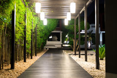 Free Soft Focus Of Black Wooden Garden Path Over White Prebbles Floor Stock Images - 98290304