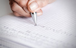 Soft focus pen writing by female hand Royalty Free Stock Image