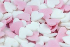 Soft focus pink and white heart candy pastel background for Valentines day. Mellow, sweet, love royalty free stock photo