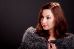 Soft focus portrait of beautiful young woman wearing a fur coat.. Stock Images