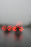Soft Focus Rainy View From Car. Soft focus view from inside car on a rainy afternoon showing the combined effect of soft focus and the water distortion Royalty Free Stock Image