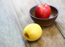 Soft focus red and yellow apple in bowl Royalty Free Stock Photography