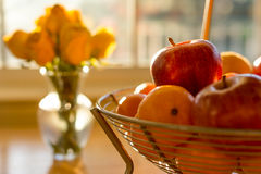 Soft focus ripe apple fruit in basket on wooden table illuminate. D by afternoon sunlight Stock Images