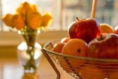 Soft focus ripe apple fruit in basket on wooden table illuminate Stock Images