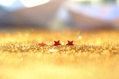 Soft focus and selective image on red star on Gold light bokeh t Stock Photos