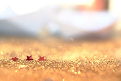 Soft focus and selective image on red star on Gold light bokeh t Royalty Free Stock Photos