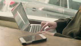 Young woman student works remotely at cafe stock footage