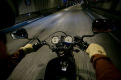 POV of biker ride motorcycle in tunnel royalty free stock image