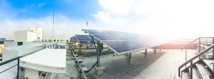 Soft focus of Solar panels or Solar cells on factory rooftop or terrace with sun light, Industry in Thailand, Asia. royalty free stock photo