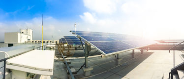 Soft focus of Solar panels or Solar cells on factory rooftop or terrace with sun light, Industry in Thailand, Asia. Stock Photo