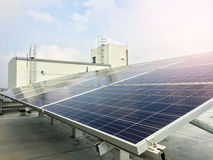 Soft focus of Solar panels or Solar cells on factory rooftop or terrace with sun light, Industry in Thailand, Asia. Can saving energy. Sun energy. renewable royalty free stock photo