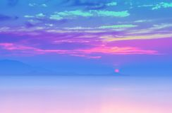 Soft focus sunset at the sea with purple ,violet color filter. Effect trendy color background stock image