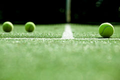 Soft focus of tennis ball on tennis grass court. Royalty Free Stock Images
