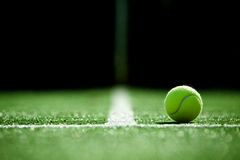 Soft focus of tennis ball on tennis grass court. Royalty Free Stock Photo