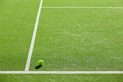 Soft focus of tennis ball on tennis grass court good for backgro Royalty Free Stock Photos