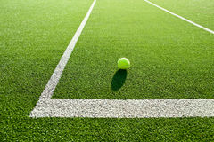 Soft focus of tennis ball on tennis grass court good for backgro Stock Photography
