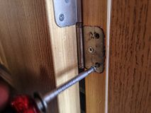 Soft focus to screw on the door. Soft  to screw on the door, home, wooddoor stock images