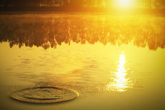Soft focus of water wave in lake with mist and sunrise in the mo Royalty Free Stock Photo