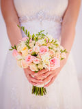 Soft focus. Wedding bouquet in bride's cookies Royalty Free Stock Photography