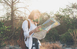 Soft focus of woman traveler with backpack checks map to find Path is a goal. Vintage tone Stock Images