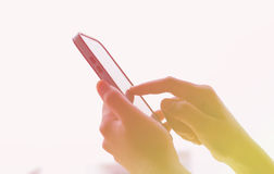 Soft focus , Woman Using a Smart Phone Stock Photography