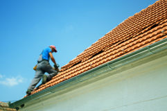 Soft focus of worker on the roof Royalty Free Stock Photography