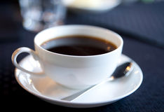 Soft-focused cup of morning coffee Stock Images