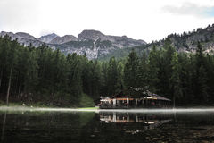 A soft fog surrounded the chatel of Ghedina Lake. Dark colors and soft fog around Chalet of Ghedina Lake royalty free stock images
