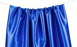 Soft folds of deep blue silk texture. Stock Image
