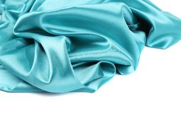 Soft folds and highlights of light blue silk. Royalty Free Stock Image