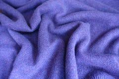 Soft folds on violet woolen jersey fabric. Soft folds on violet woollen jersey fabric Royalty Free Stock Photos