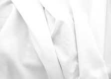 Soft folds of white cloth Stock Images