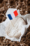 Soft french cheese and flag Royalty Free Stock Images