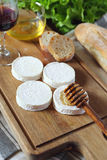 Soft French goat cheese Rocamadour, bread, honey, lettuce and gl Royalty Free Stock Images