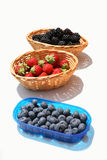 Soft fruits. Baskets of strawberries, blackberries and blueberries Royalty Free Stock Photography