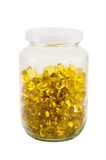 Soft gel capsule in glass bottle Royalty Free Stock Photo