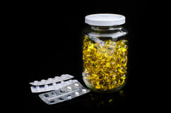Soft gel capsule in glass bottle Royalty Free Stock Photography