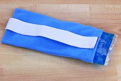 Soft gel-filled cold and hot pack. A blue reusable soft gel-filled cold and hot pack to relieve pain inside a fabric pouch Royalty Free Stock Photography