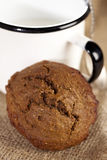 Soft ginger cookie with milk in white enamel mug Stock Photo