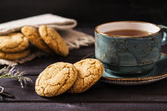 Soft ginger cookies. Soft ginger cookie with cracks on a dark wooden background Stock Photography