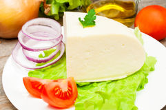 Soft goat cheese in a bowl with vegetables Royalty Free Stock Photography