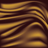 Soft golden silky fabric. Silk waves. Background. Stock Image
