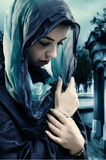 Soft gothic fantasy. A melancholic yet serene woman wears a headscarf in shades of blue Royalty Free Stock Image