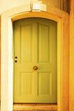 Soft green door in France Stock Photo
