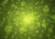 Soft green and gold bokeh background. Abstract spring concept. Stock Photography