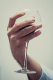 Soft hand with a glass of wine Stock Images