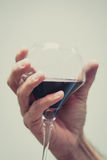 Soft hand with a glass of wine Stock Photography